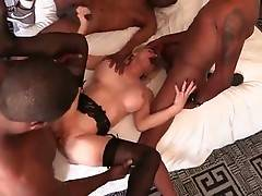 Big boobed older slut gets her pussy and mouth filled with black rods.