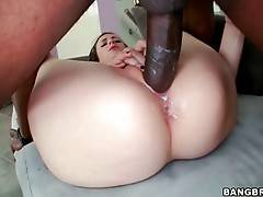 Cutie with her legs widely open gets her pussy smashed with huge black cock.